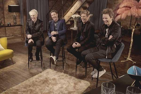 Duran Duran watching over their career footage