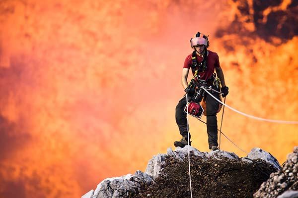 Man absailing near a volcano